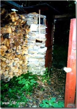 New Jersey Outhouse by the wood pile. Check out the Axe!
