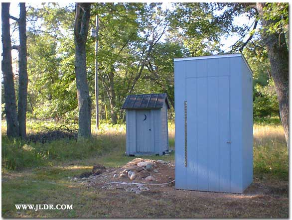 New and Old Outhouses in Curran, Michigan