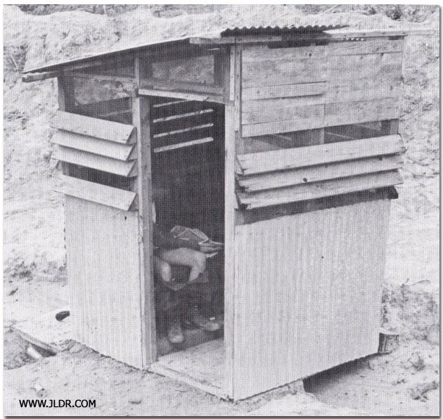 Pants down using the Latrine during the Vietnam War