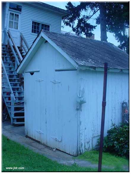 The Outhouse Front and Right Side View