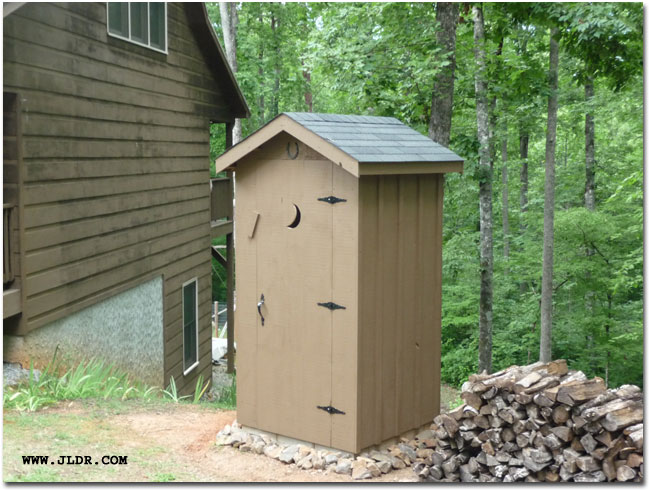 The outhouse with stain on it