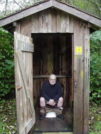 A man in the women's outhouse; You gotta go when you gotta go!