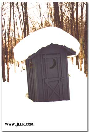 A snowy winter outhouse in Michigan