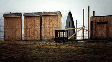 Outhouses built by the Amish stand ready to sell