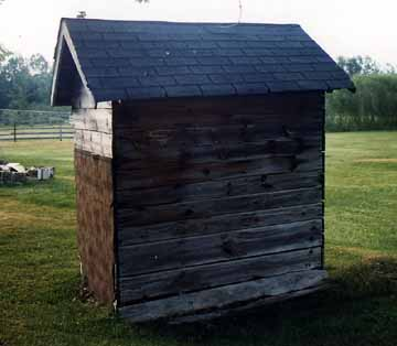 Back View of the Outhouse Showing the Holes
