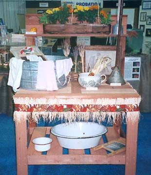 A display of washboards, rapid washers, chamber pots and other items