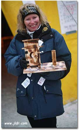 Sherry holding the 2001 Outhouse Classic Trophy