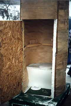 Inside of the Wood Veneered Outhouse