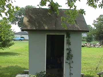 Front View of the Concrete Outhouse