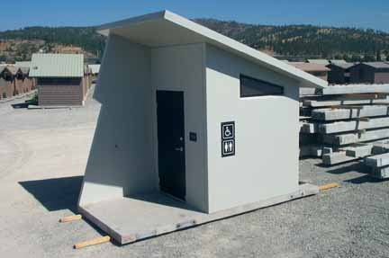 A Prefabricated Concrete Outhouse Ready for Loading