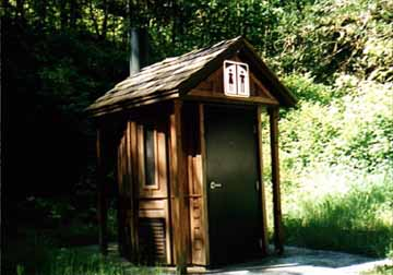 Front View of a Fancy Campground Outhouse in Oregon