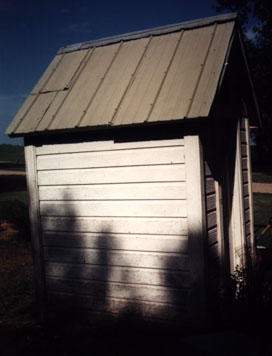Another view of the right side showing the tin roof