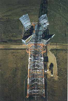 An Aerial HIGH UP View of an AT&T Microwave Radio Relay Site Outhouse