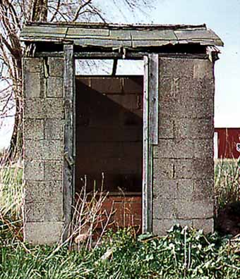 Closeup of Cement Block Outhouse