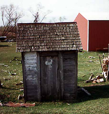 Michigan Outhouse featuring a Rooster on the Door