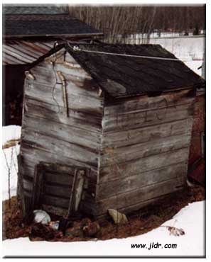 The other side of the old outhouse