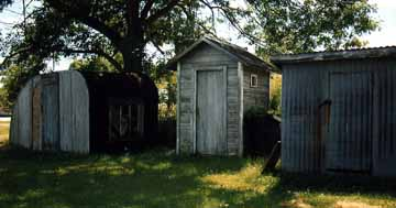 Outhouse Nestled with Two Other Buildings