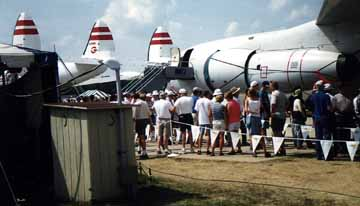 Constellation Airliner with Outhouse Shed in Foreground