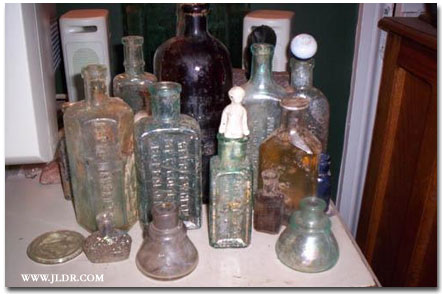 More bottles found during the dig; Notice the man