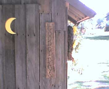 Plaque next to the Outhouse door