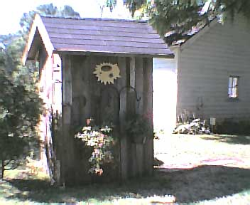 Back view of the outhouse