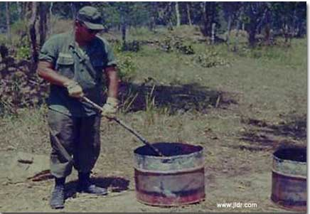 Burning excrement in Viet Nam behind the enemy lines; smoke could be seen for miles!