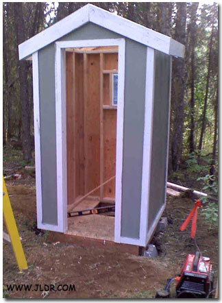 Outhouse mounted on pilings